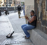 Jazz in the street. Unknown musician performs jazz music in the street of Madrid (Spain) 21 July 2008 Royalty Free Stock Photo