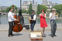 Jazz street performers on the Pont St Louis, Paris, France stock photos