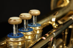 Jazz trumpet. Detail of jazz trumpets on a black background for music promotion Royalty Free Stock Image
