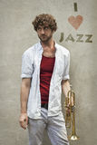 Jazz Trumpet. Curly haired man plays jazz trumpet outside Stock Photography