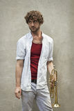 Jazz Trumpet. Curly haired man plays jazz trumpet outside Royalty Free Stock Photography