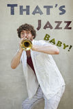 Jazz Trumpet. Curly haired man plays jazz trumpet outside Royalty Free Stock Photo