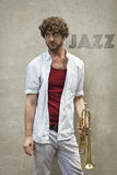 Jazz Trumpet. Curly haired man plays jazz trumpet outside Stock Photos