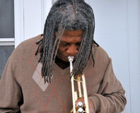 Jazz trumpet player. African american jazz trumpet player with his horn outdoors Stock Photo