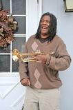 Jazz trumpet player. African american jazz trumpet player with his horn outdoors Royalty Free Stock Photography