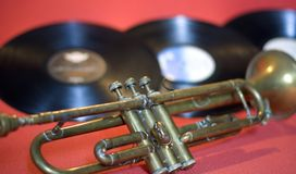 Jazz vinyls, and an ancient trumpet. Music is poetry for lovers of melodies Stock Images