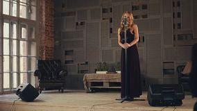 Jazz vocalist in dark dress perform on stage. Saxophonist in suit walk on stage stock video