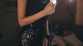 Jazz vocalist in glowing elegant black dress perform on stage. Dancing. Retro. Style stock footage