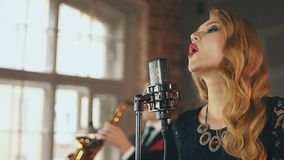Jazz vocalist perform on stage click fingers. Retro style dress. Saxophonist. Dance stock footage
