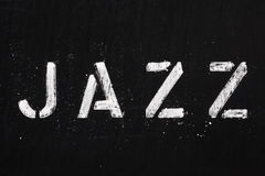JAZZ. The word Jazz in stencil letters on a blackboard stock photography
