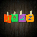 Jazz. The word Jazz written on sticky colored paper over dark planks background Stock Image