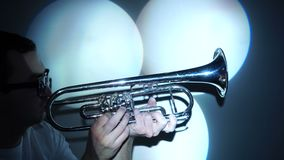 Jazzman plays the trumpet in the three spinning light beam stock footage