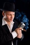 Jazzman and retro microphone Stock Photo