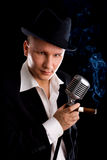 Jazzman and retro microphone Stock Image