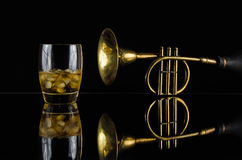 Jazzy Bar. Image of a drink and a horn with reflection Royalty Free Stock Photography