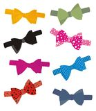 Jazzy bow ties. Illustration of eight coloured and patterned silk bow ties Stock Images