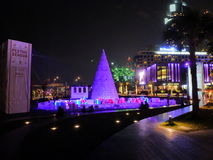 JBR Dubai Illuminated Christmas tree. JBR Dubai pink Illuminated Christmas tree with gifts around Jumeirah Beach Residence Stock Image