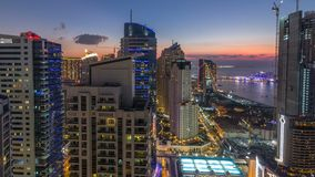 JBR and Dubai marina after sunset aerial day to night timelapse stock video footage