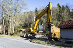 JCB JS200 LC Excavator. This is a large excavator that has recently been used to dig into the river Tista Royalty Free Stock Photo