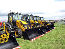 JCB line at Moorgreen show. A line of JCB's at the Moorgreen country show, Watnall, Nottinghamshire,England, UK, 2012 Royalty Free Stock Photo