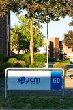Dusseldorf Germany July 1st 2018: JCM global sign post of their office building in duesseldorf royalty free stock images