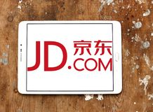 JD.com logo. Logo of JD.com on samsung tablet on wooden background. JD.com is a Chinese e-commerce company.  It is one of the two largest B2C online retailers in Royalty Free Stock Photography