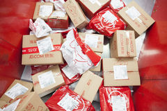 JD.com packages. Gu'an, China - June 14, 2016: JD.com packages awaiting sorting at Northeast China based Gu'an distribution facility Gu'an, China stock photos