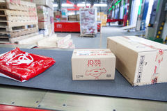 JD.com packages. Gu'an, China - June 14, 2016: JD.com packages awaiting sorting at Northeast China based Gu'an distribution facility Gu'an, China royalty free stock images