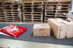 JD Com-pakketten stock foto