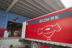 JD.com shipping trucks. Gu'an, China - June 14, 2016: JD.com truck receiving incoming goods and preparing shipments at the Northeast China based Gu'an warehouse stock image