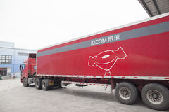 JD.com shipping trucks. Gu'an, China - June 14, 2016: JD.com truck receiving incoming goods and preparing shipments at the Northeast China based Gu'an warehouse stock photography