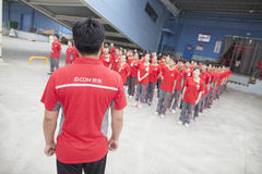 JD.com staff. Gu'an, China - June 14, 2016: JD.com staff receiving instruction from manager at Northeast China based Gu'an warehouse and distribution facility stock image