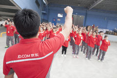 JD.com staff. Gu'an, China - June 14, 2016: JD.com staff receiving instruction from manager at Northeast China based Gu'an warehouse and distribution facility royalty free stock photos