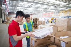 JD.com staff receiving incoming goods Royalty Free Stock Photography