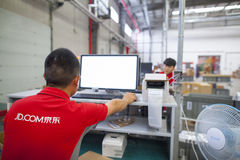JD.com staff receiving incoming goods Royalty Free Stock Image