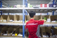 JD.com staff receiving incoming goods. Gu'an, China - June 14, 2016: JD.com staff receiving incoming goods, sorting products, and preparing shipments at the Stock Images