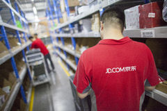 JD.com staff receiving incoming goods Stock Photography