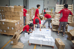 JD.com staff receiving incoming goods. Gu'an, China - June 14, 2016: JD.com staff receiving incoming goods, sorting products, and preparing shipments at the Stock Photo