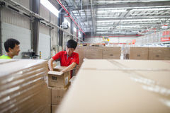 JD.com staff receiving incoming goods, sorting products, and preparing shipments at the Northeast China based Gu'an warehouse. Gu'an, China - June 14, 2016: JD stock photography