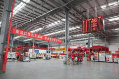 JD.com staff sorting packages. Gu'an, China - June 14, 2016: JD.com inside view of KPI board at Northeast China based Gu'an warehouse and distribution facility royalty free stock photography