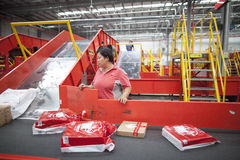 JD.com staff sorting packages. Gu'an, China - June 14, 2016: JD.com staff receiving incoming goods, sorting products, and preparing shipments at the Northeast royalty free stock photos