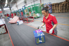 JD.com staff sorting packages. Gu'an, China - June 14, 2016: JD.com staff receiving incoming goods, sorting products, and preparing shipments at the Northeast stock photography