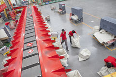 JD.com staff sorting packages. Gu'an, China - June 14, 2016: JD.com staff receiving incoming goods, sorting products, and preparing shipments at the Northeast royalty free stock photography