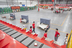 JD.com staff sorting packages. Gu'an, China - June 14, 2016: JD.com staff receiving incoming goods, sorting products, and preparing shipments at the Northeast stock images