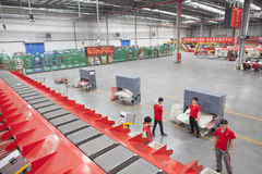 JD.com staff sorting packages. Gu'an, China - June 14, 2016: JD.com staff receiving incoming goods, sorting products, and preparing shipments at the Northeast royalty free stock image