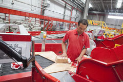 JD.com staff sorting packages. Gu'an, China - June 14, 2016: JD.com staff receiving incoming goods, sorting products, and preparing shipments at the Northeast royalty free stock images