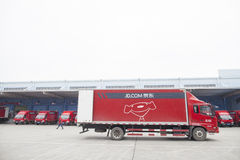 JD.com trucks. Gu'an, China - June 14, 2016: JD.com trucks receiving incoming goods and preparing shipments at the Northeast China based Gu'an warehouse and stock images