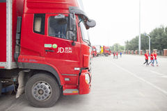 JD.com trucks. Gu'an, China - June 14, 2016: JD.com truck receiving incoming goods and preparing shipments at the Northeast China based Gu'an warehouse and stock photos