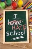 Je déteste l'école, de nouveau au concept d'école écrit sur le tableau noir Image libre de droits