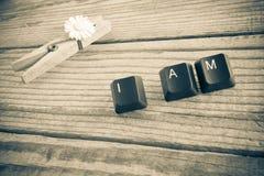 Je suis ai écrit avec des clés de clavier sur le fond en bois, effe de sépia Photo stock
